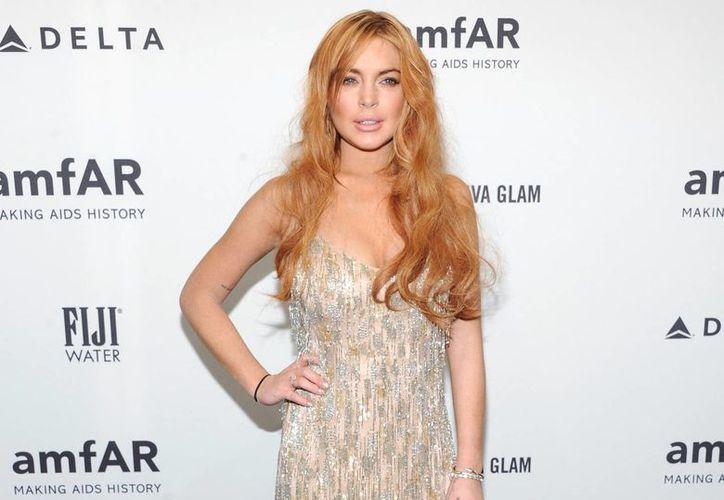 Lindsay Lohan, quien se encuentra en Brasil trabajando, anunció esta madrugada a través de su cuenta de Twitter que está embarazada. (Agencias)