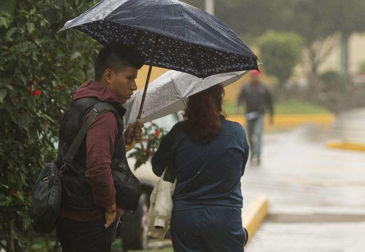 El SMN informó que las precipitaciones continuarán en buena parte del país debido a diversos fenómenos. (Notimex)