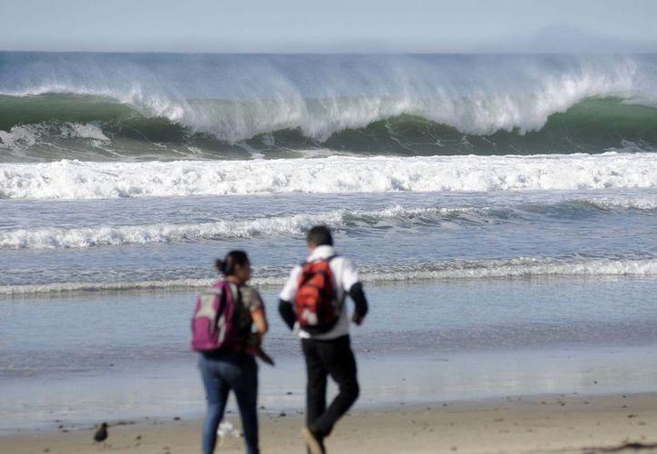 En el Golfo de Tehuantepec se esperan olas de hasta 2.7 metros de altura. (Archivo/Notimex)
