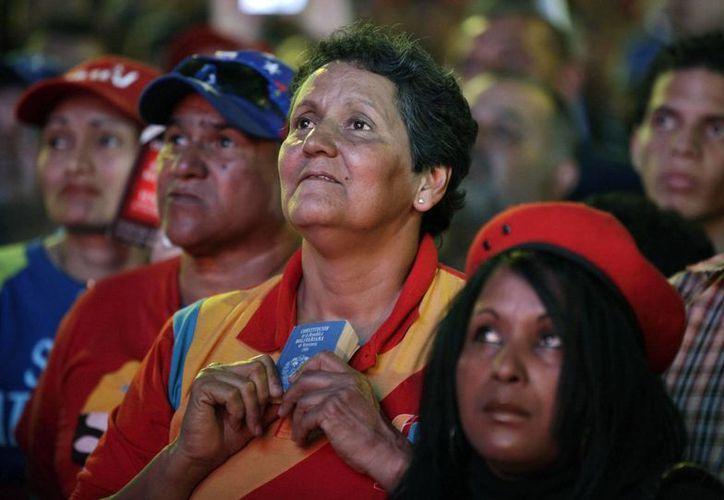 El funeral de Chávez dejó una honda pena entre los asistentes a la Capilla Ardiente de la Academia Militar en Venezuela. (Agencias/Archivo)