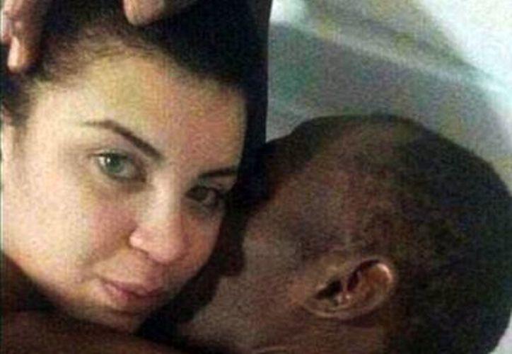 Jady Duarte compartió por Whatsapp una imagen con Usain Bolt a un grupo de amigas... el resto es historia. (@MailOnline)