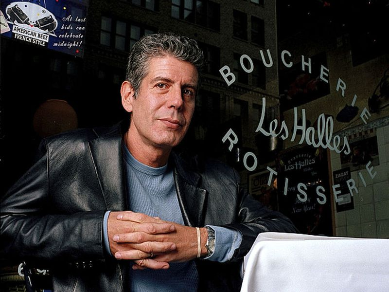 Anthony Bourdain, the owner and chef of Les Halles restaurant, sitting at one of the tables in New York.