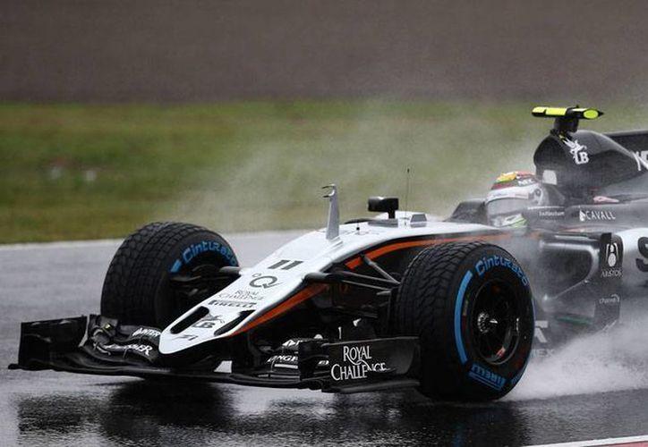 El piloto Sergio 'Checo' Pérez tuvo un día de luz y sombra en el Gran Premio de Japón. El ganador fue Lewis Hamiltón. (AP)