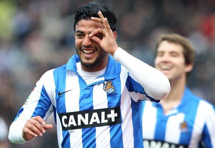 A falta de ocho fechas para que termine la liga, Vela lleva trece goles y la Real Sociedad está  en cuarto sitio. (EFE)