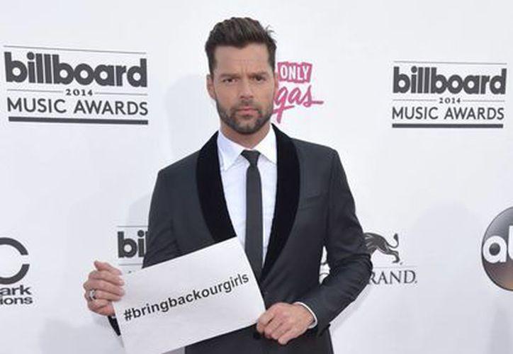 Ricky Martin es una de las personalidades de la farándula que exigen que el grupo extremista Boko Haram libere a más de 200 niñas secuestradas. (Foto: AP)