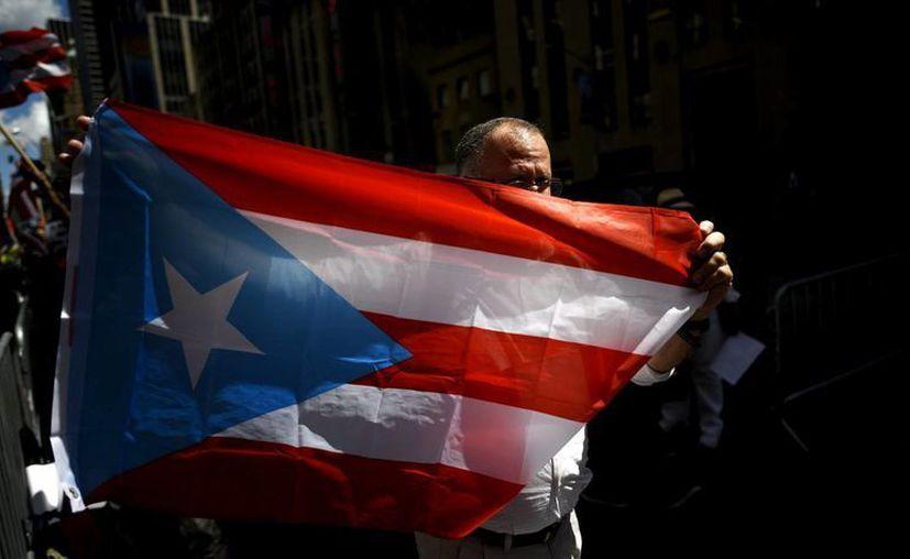 El perfil de la población que emigra de Puerto Rico a EU es el de una persona de 29 años, el doble que hace 13 años. (EFE/Archivo)