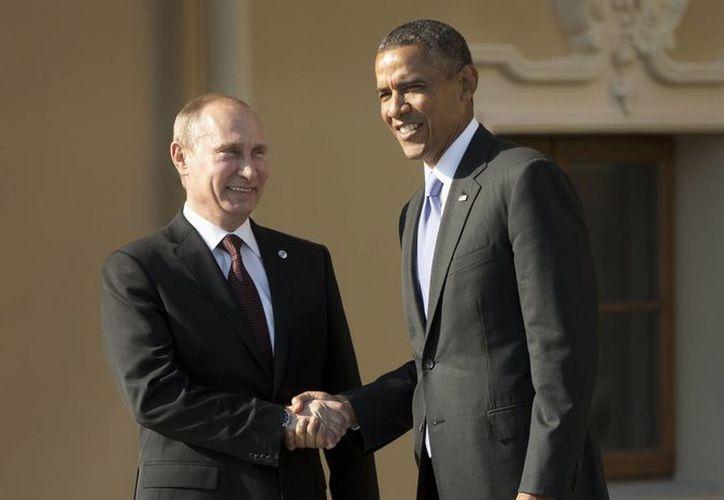 Los presidentes de Rusia y Estados Unidos se saludan a su arribo a San Petersburgo. (Agencias)