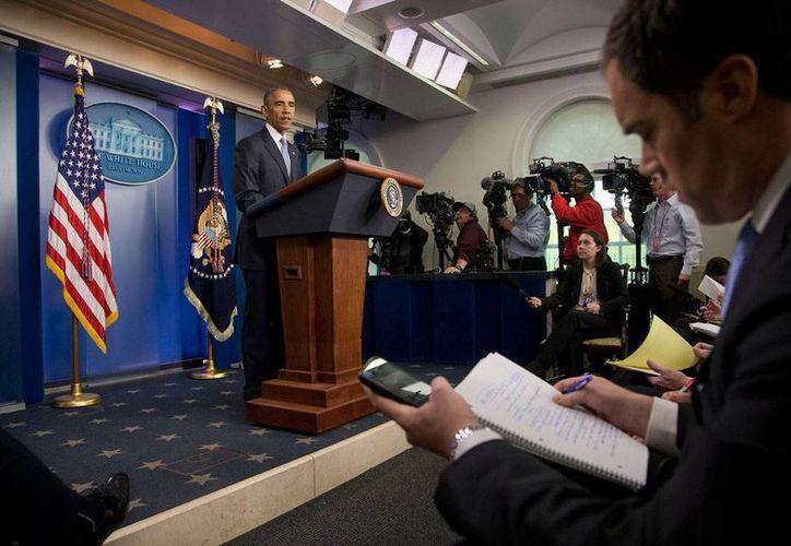 """En conferencia de prensa, Barack Obama manifestó su pesar por la muerte de los dos rehenes y ofreció condolencias a sus familiares. """"No hay palabras que puedan equipararse a su pérdida"""", afirmó. (Foto AP)"""