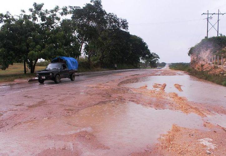 La precipitaciones han ocasionado que varios de los caminos se encuentren totalmente abnegados; presentan un 90% de afectaciones. (Edgardo Rodríguez/SIPSE)