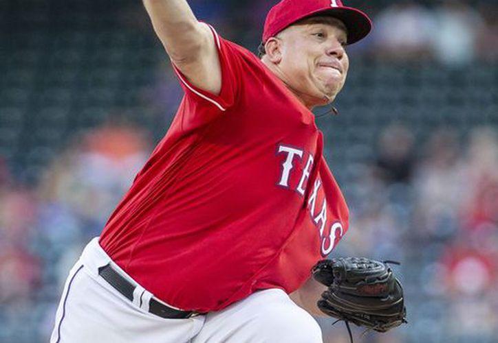 Bartolo Colón es el pitcher de los Rangers de Texas. (vanguardia.com)
