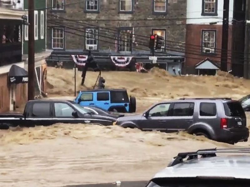 Updates with more details throughout from government officials vowing to rebuild. Updates rainfall totals, adds quotes from governor and others.