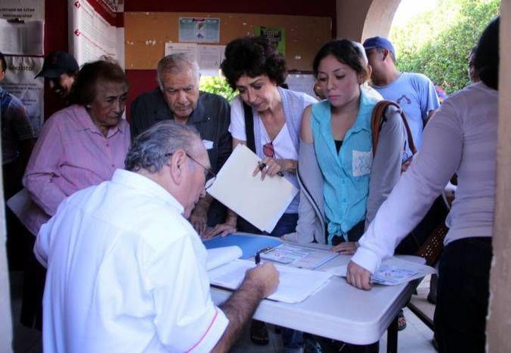 Los distritos electorales de Mérida ya no serían siete, sino seis, de acuerdo con una propuesta del INE. (Foto de contexto de Milenio Novedades, de un módulo del Registro Federal de Electores)