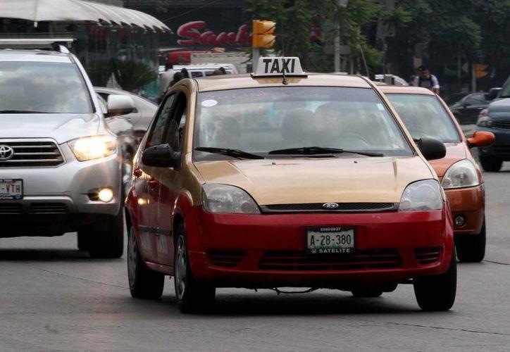 Smart Taxi ofrece al usuario una evaluación de la experiencia y calidad en el servicio de los choferes. En la imagen, un taxi de la Ciudad de México. (Notimex)