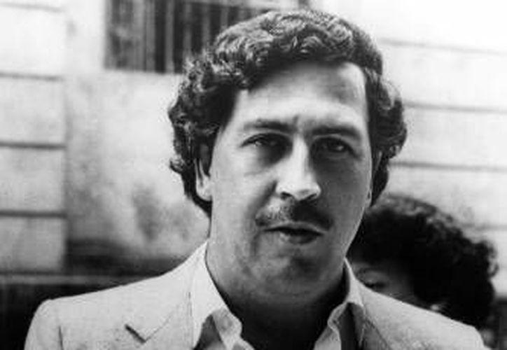 """Tres generales retirados que diseñaron la estrategia de la caída del narcotraficante Pablo Escobar serían parte de un grupo élite que Colombia envió a México para apoyar en la búsqueda de """"El Chapo"""". (Archivo/ AP)"""