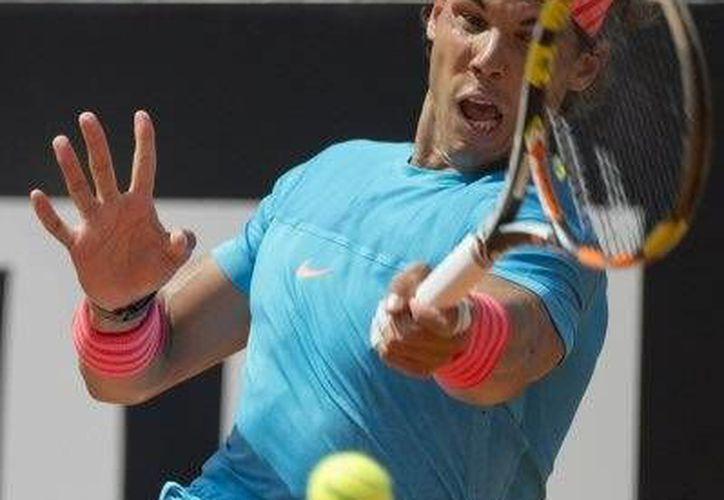 El tenista español avanzó a cuartos de final, tras vencer a John Isner (AP)