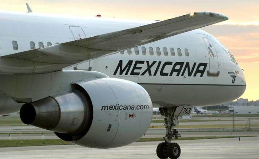 Uno de los acuerdos logrados en el juzgado que lleva el proceso mercantil de Mexicana consiste en crear un fondo para apoyar a mil 200 trabajadores. (Agencias/Foto de archivo)