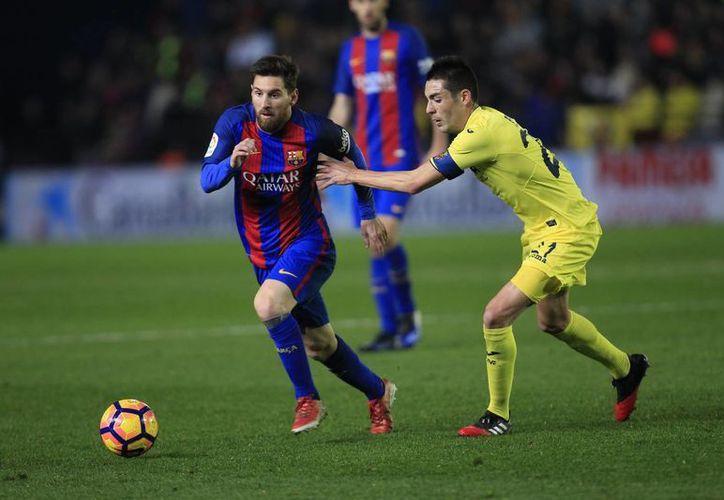 Este domingo el Barcelona apenas sacó un empate en la Liga de España mientras que Juventus hiló su victoria número 26 como local dentro del campeonato de la Serie A, lo cual es un récord. (AP)