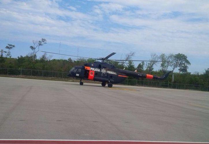 El helicóptero MI-17 llegó a Cancún y apoyará las acciones en los incendios de Benito Juárez y Solidaridad. (Redacción/SIPSE)