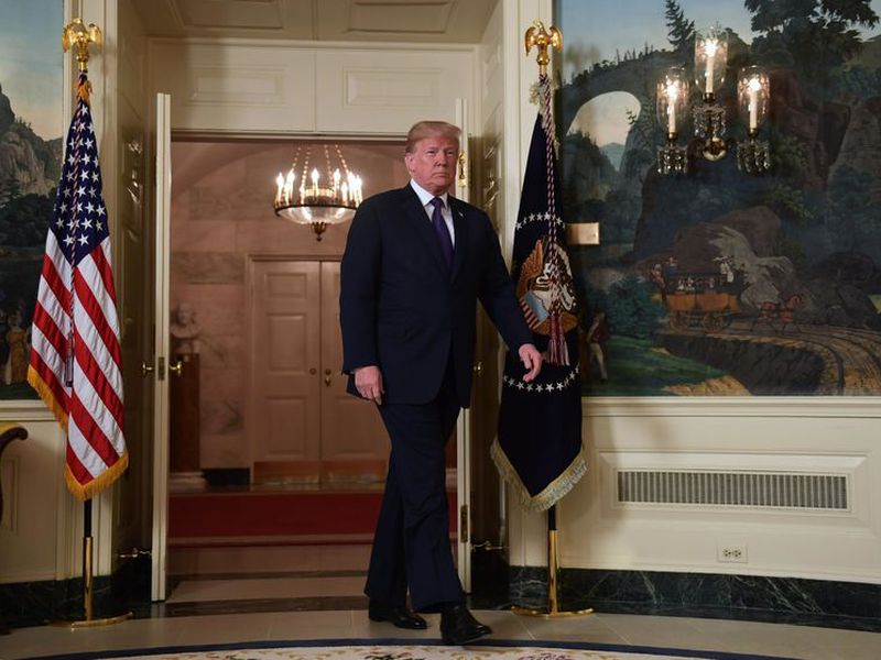 Donald Trump enters to speak in the Diplomatic Reception Room of the White House on Friday, in Washington, about the United States' military response to Syria's chemical weapon attack on April 7. (AP).
