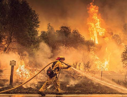 Deadly California wildfire rages largely unchecked