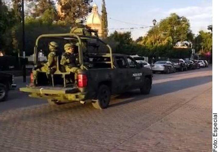 A la par de efectivos militares, arribaron esta tarde agentes de la Fiscalía General del Estado para iniciar una indagatoria. (Agencia Reforma)