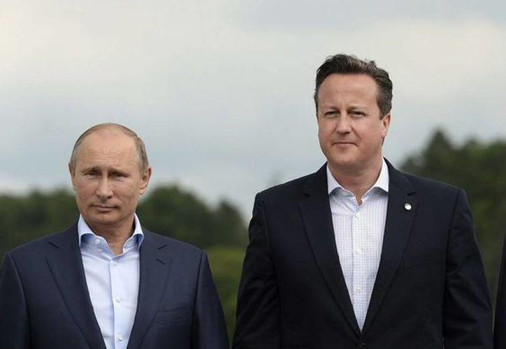 El presidente de Rusia, Vladímir Putin, el primer ministro británico David Cameron y el mandatario de EU Barack Obama. (EFE)