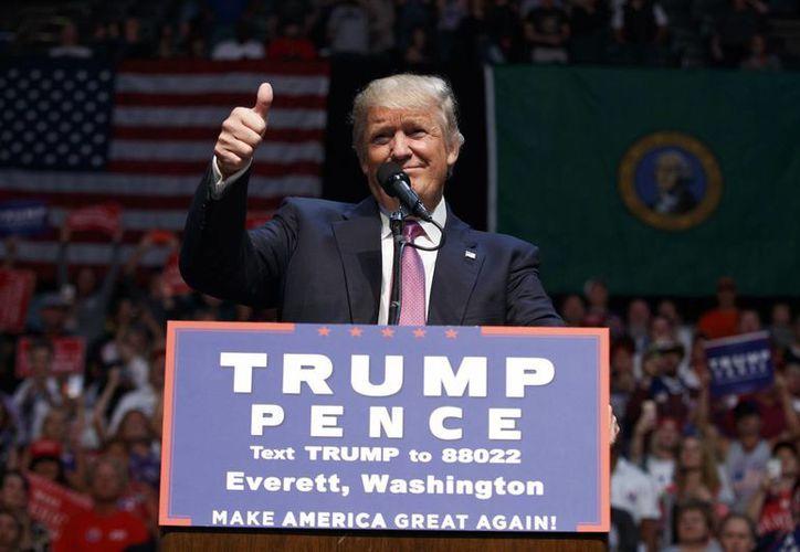 La reunión entre el candidato republicano a la presidencia de EU, Donal Trump, mantendrá una reunión con el presidente Peña Nieto se realizará entre las 12:00 horas y 15:00 horas en Los Pinos. (AP/Evan Vucci)