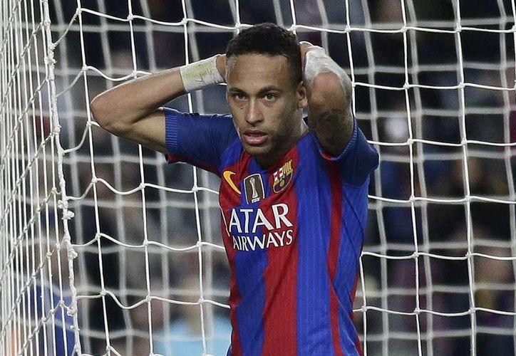 El FC Barcelona ha estado envuelto en problemas legales por la transferencia del brasileño Neymar desde 2013.(Manu Fernandez/AP)