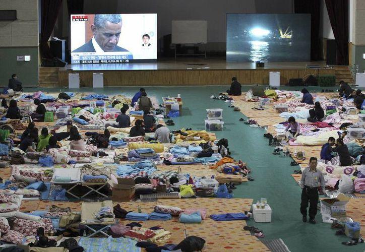Las condolencias del presidente Obama por el hundimiento del ferry fueron transmitidas por televisión a todo el país. (AP)
