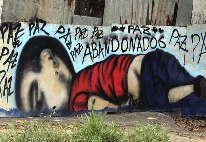 El asesinato de un bebé en Oaxaca recuerda el caso del pequeño Aylan, ahogado en playas turcas, que copó las redes sociales en septiembre pasado. (Actualidad RT)
