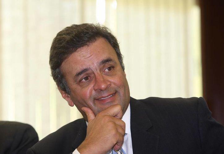 Neves iniciará la campaña con una base de apoyo que las encuestas sitúan en 22 por ciento, frente al 38 por ciento que le atribuyen a Rousseff. (poderonline.ig.com.br)