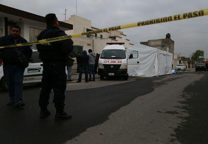 Las autoridades indicaron que el asesinato de 11 personas en Tizayuca el miércoles por la noche, fue por un ajuste de cuentas. (Milenio.com)