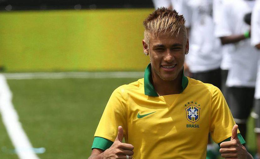 Neymar tiene contrato con Santos hasta después del Mundial de 2014. (EFE)