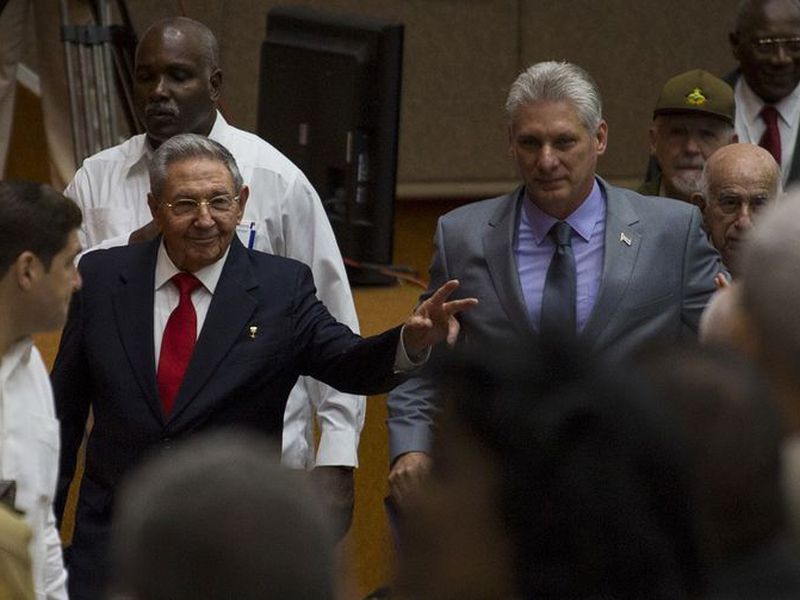 Cuba´s President Raul Castro, center left, enters the National Assembly followed by his successor Miguel Diaz-Canel, center right, for the start of two-day legislative session in Havana, Cuba.