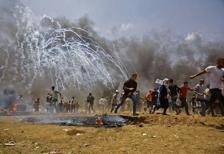 Las protestas estallaron este lunes en la frontera de la Franja de Gaza con Israel en víspera del traslado de la embajada estadounidense de Tel Aviv a Jerusalén. (RT)