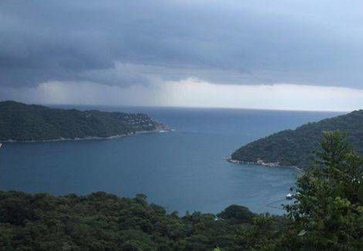 """La tormenta tropical """"Marie"""", que se localiza al sur-suroeste del puerto de Acapulco. (Javier Trujillo/Milenio)"""