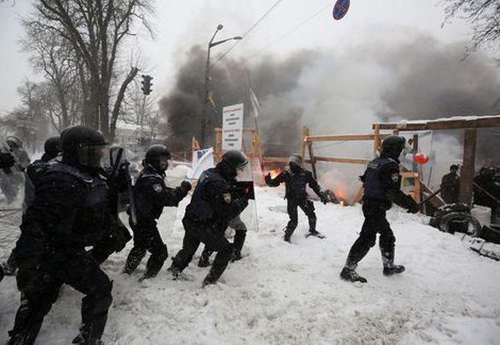 Los manifestantes exigen la apertura de un tribunal nacional para luchar contra la corrupción. (Milenio)