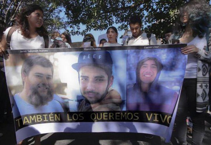Javier Salomón Aceves Gastélum, de 25 años, Jesús Daniel Díaz, de 20, y Marco Francisco García Ávalos de 20, desparecieron el 19 de marzo. (Foto: EPA)