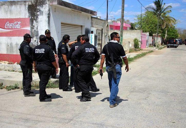 Tras el asalto cometido el 9 de mayo contra un diligenciero, los cuatro acusados, entre ellos un yucateco, fueron presentados este jueves. En la foto, operativo de búsqueda en Umán. (Pallota/SIPSE)
