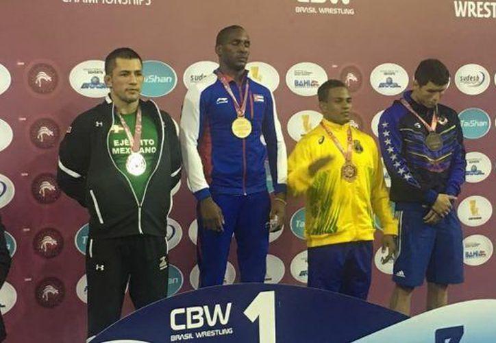Obtuvieron una medalla de  plata y cuatro de bronce; el titular comentó que los deportistas dieron su mejor esfuerzo durante los combates.  (Foto: Especial)