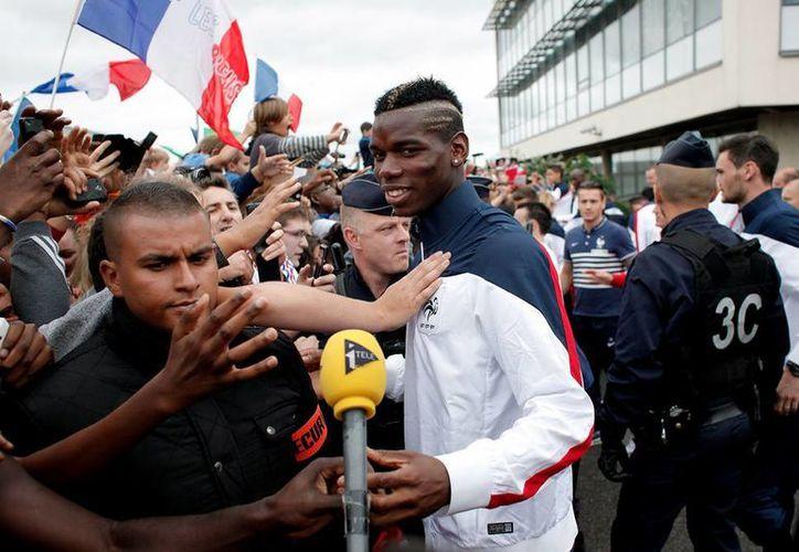 El ambiente en Francia hacia Les Bleus es muy distinto al que les dispensó en el Mundial de Sudáfrica, donde protagonizó vergonzosos actos de indisciplina. (AP)