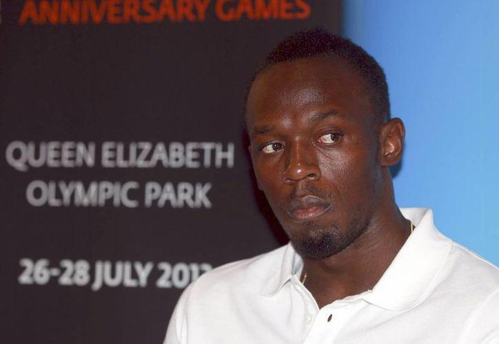 Sólo voy a seguir corriendo, usando mi talento y tratando de mejorar este deporte: Bolt. (EFE)