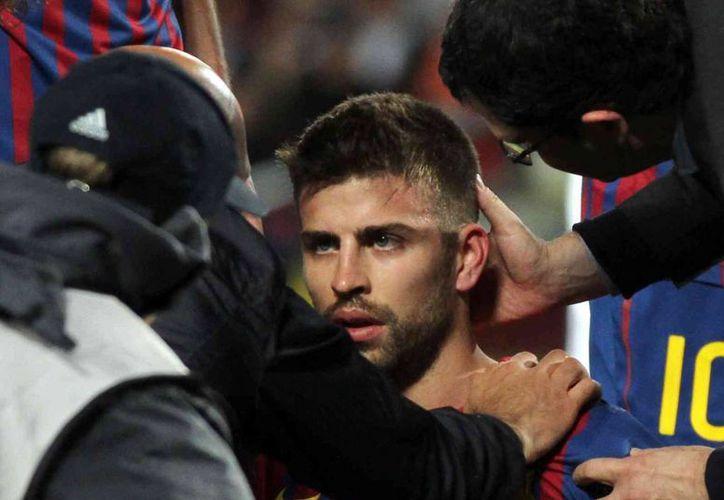 Piqué se perderá los duelos contra el Almería y el Real Valladolid en la Liga de España. (Archivo/Agencias)