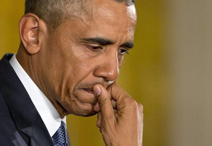 """""""Cada vez que pienso en esos niños (víctimas de masacres), me siento molesto"""", dijo Obama sin poder evitar que algunas lágrimas rodaran por sus mejillas. (Folto: AP)"""