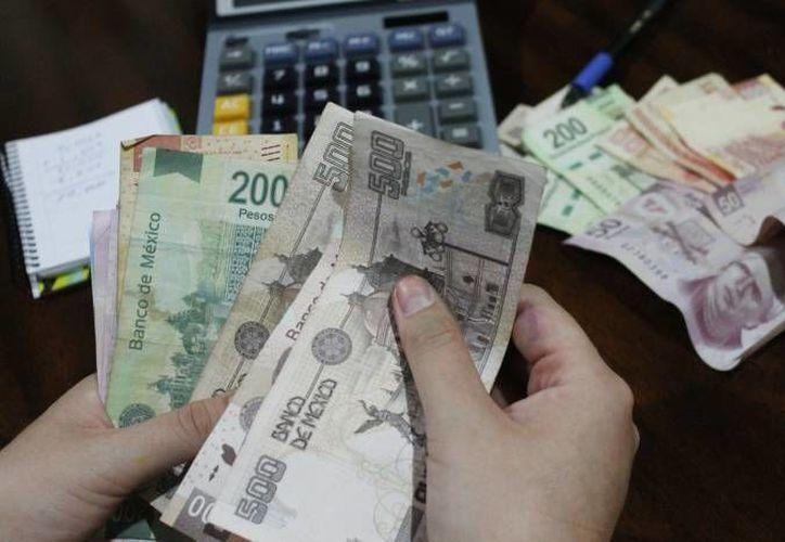 En 2012, el ingreso mensual promedio de un trabajador en Quintana Roo era de cinco mil 950 pesos. (Archivo/SIPSE)