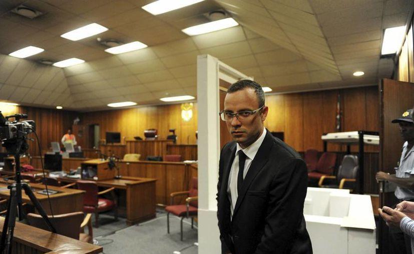 Pistorius a su llegada al juicio por el asesinato de su novia, la modelo Reeva Steenkamp, en el Tribunal Superior de Pretoria, Sudáfrica. (EFE)