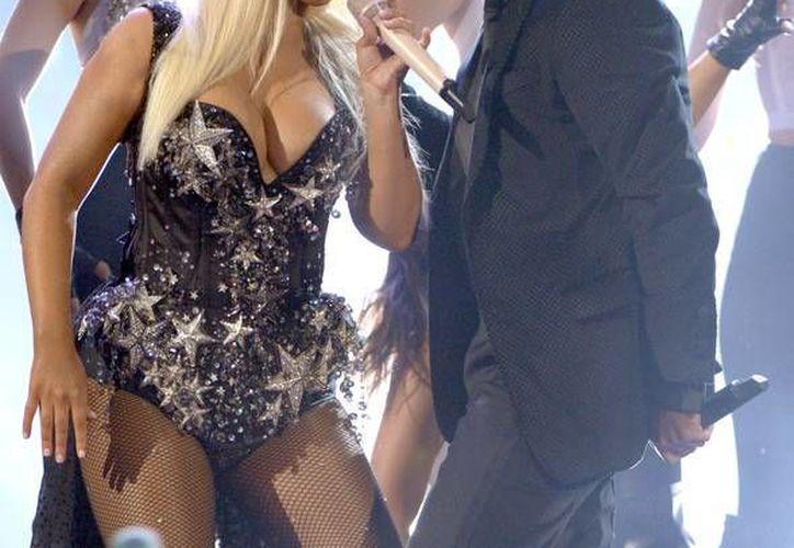 Aguilera y Pitbull se presentaron en la reciente entrega de los American Music Awards. (www.zimbio.com)