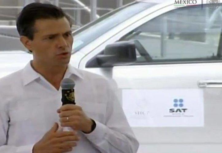 El presidente Enrique Peña Nieto, en su anuncio del cierre de cuatro garitas aduanales en Quintana Roo. (Presidencia de la República/SIPSE)