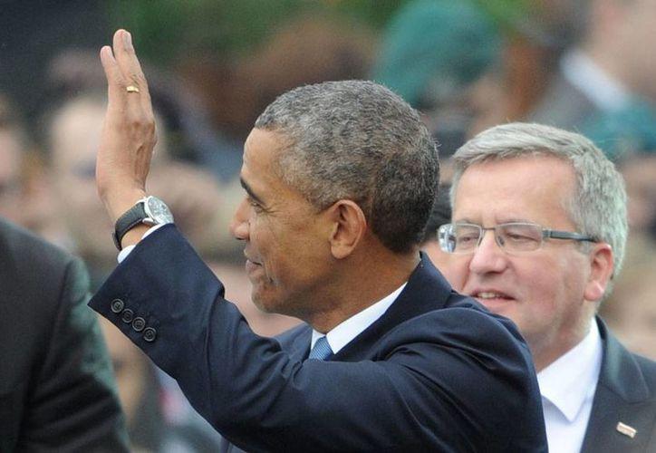 El presidente de EU, Barack Obama (de perfil), estuvo ayer en Polonia, para la celebración del 25 aniversario de las primeras elecciones libres en esa nación. (AP)