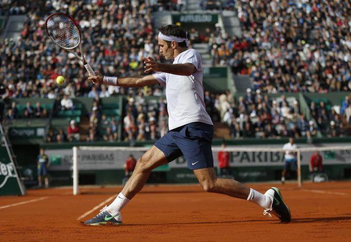 Federer hizo trizas al indio Somdev Devvarman: 6-2, 6-1 y 6-1. (Agencias)